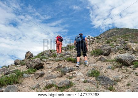 ALTAY, RUSSIA - JULY 18, 2007: Tourists walking in the Altay Mountains Russia.