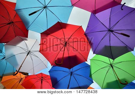Colorful Umbrellas And Cloudy Sky