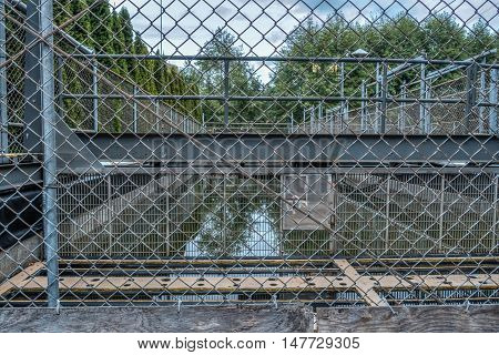 HDR image of fences around a salmon hatchery in Tumwater Washington.