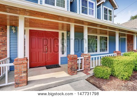 Front Entry Red Door With Concrete Floor Porch.