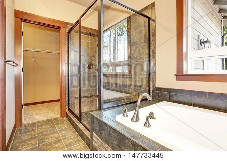 Bathroom Interior With Marble Tile Trim. View Of Glass Shower Cabin