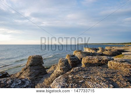 Spectacular limestone formations raukar at Byrum at the swedish island Oland in the Baltic Sea