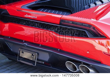 Vancouver, BC - April 20, 2015 -  On display in front of Lamborghini Vancouver, 1720 West 2nd Avenue, Vancouver, BC. Beautiful close cropped shot of the rear a gorgeous red Lamborghini, smooth lines and impecable design are complimented by black trim and