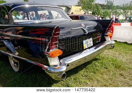 Kharkiv Ukraine - May 22 2016: Tail fin and rear lights of Soviet retro car black GAZ-13 Chayka manufactured between 1959 and 1981 is presented at the festival of vintage cars Kharkiv Retro Rally - 2016 in Kharkiv Ukraine on May 22 2016