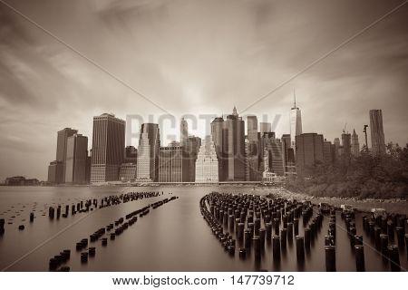 Downtown Manhattan skyline with pier wood log in New York City