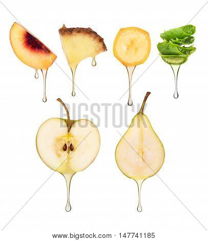 juice in the form of drops flowing from different fruits on white background