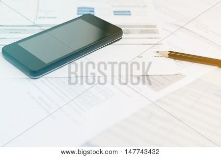 Utility bill and calculator with pencil Bill for income and expenditure Pencil with calculator on utility bill color filter style