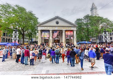Boston Massachusetts - September 5 2016: Crowd of tourists watching a public outdoor show in front of the Quincy Market.