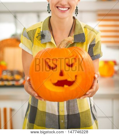 Housewife In Kitchen Showing Big Pumpkin Jack-o-lantern