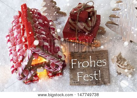 Label With German Text Frohes Fest Means Merry Christmas. Gingerbread House On Snow With Christmas Decoration Like Trees And Moose. Sleigh With Christmas Gifts Or Presents And Snowflakes.