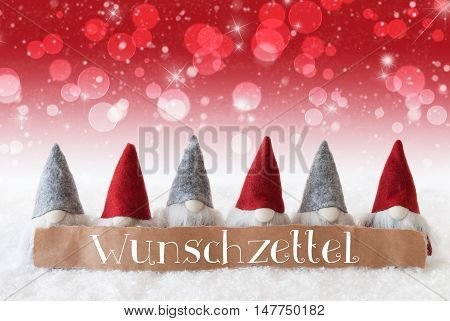 Label With German Text Wunschzettel Means Wish List. Christmas Greeting Card With Red Gnomes. Sparkling Bokeh And Christmassy Background With Snow And Stars.