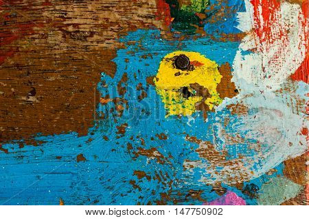 Multicolored background: old wooden multicolored surface and cracking texture
