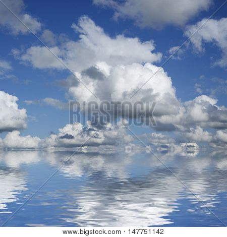 Beautiful sky and clouds over horizon. Blue sky and white clouds flaying over sea.