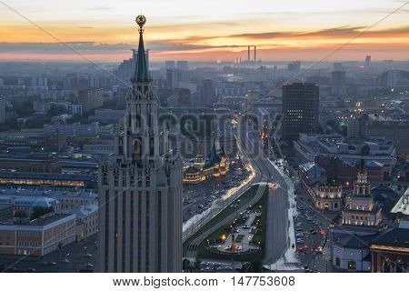 Stalin skyscraper with star on Komsomolskaya square at early morning in Moscow, Russia