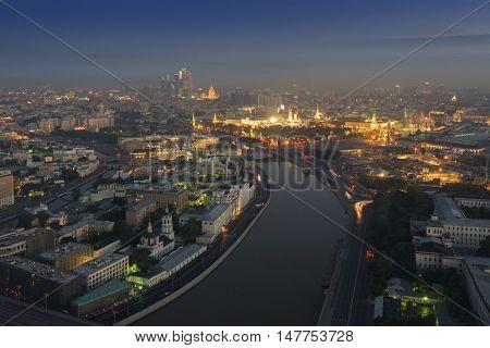 Big Moskvoretsky Bridge, Moskva river, Kremlin with illumination in Moscow, Russia, view from Stalin skyscraper on Kotelnicheskaya quay