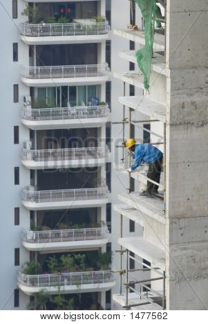 Construction Worker At High-Rise Building