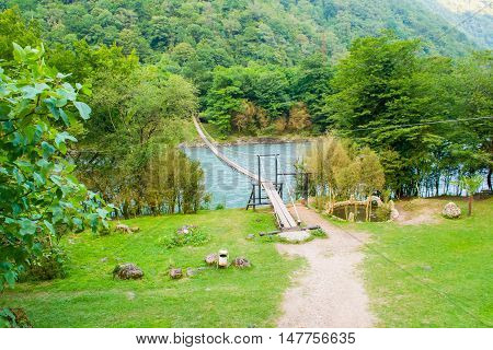 rope bridge in the mountains in summer outdoor