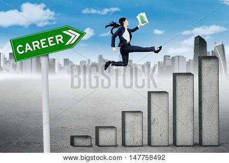 Growing career concept. Female entrepreneur jumping above career chart with career text on signpost and carrying paperwork