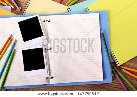 Photo album open with several blank photo print frames copy space