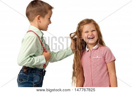 relationship between the children. Boy pulls the girl's hair