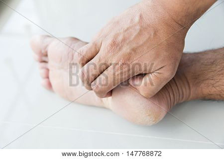 People scratch the itch with hand Foot itching Concept with Healthcare And Medicine.