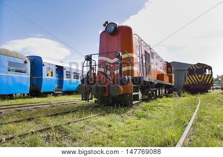 Exteriors of abandoned vintage railway carriages in rail yard