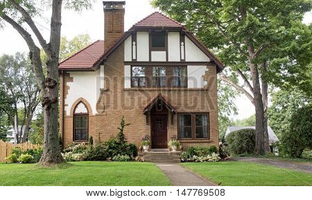 Old Tan Brick House with Red Tile Roof