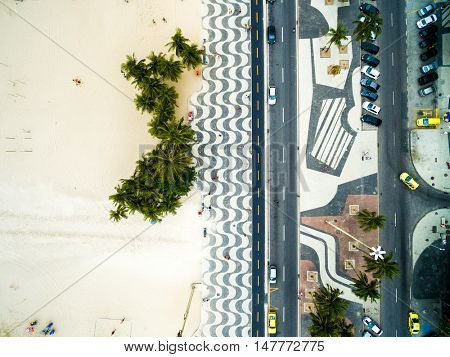 Top View of Copacabana beach with mosaic of sidewalk in Rio de Janeiro, Brazil