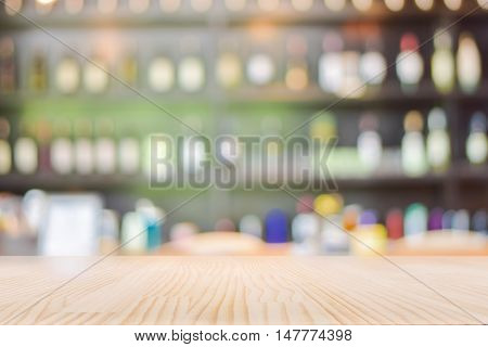 Table Top counter with Blurred Wine Liquor bottles Display Background