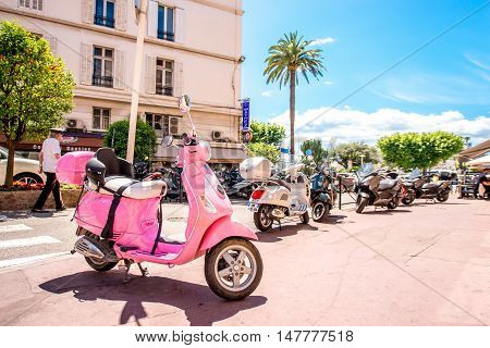 Cannes, France - June 14, 2016: Pink scooter on the street in Cannes city on the French riviera.