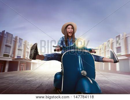 Beautiful Happy Asian Woman Riding A Scooter Raising Both Legs