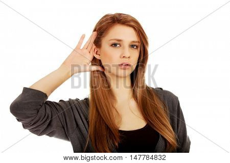 Teenage woman ovehears a conversation