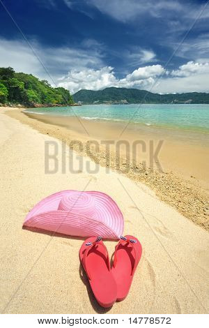 Beautiful beach landscape with hat and flip-flops in Thailand