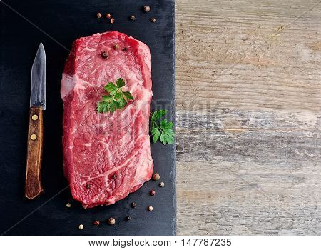 Pieces of crude meat with parsley and pepper