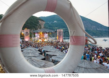 BUDV- JULY 18 : CROWD IN FRONT OF THE DANCE PARADISO STAGE MORNING SESSION AT BEACH AT SEA DANCE FESTIVAL 2015 MUSIC FESTIVAL JULY 18 2015 IN BUDVA JAZ BEACH MONTENEGRO