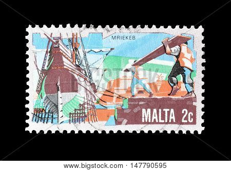 MALTA - CIRCA 1981 : Cancelled postage stamp printed by Malta, that shows Ship building.