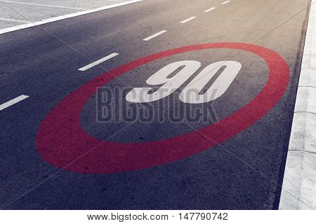 90 kmph or mph driving speed limit sign on highway road safety and preventing traffic accident concept.