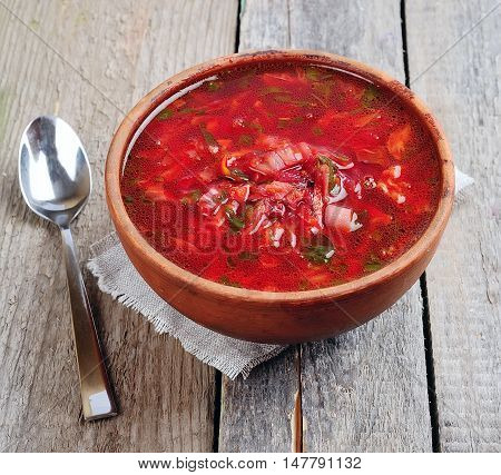 Red borscht on wooden backgrounds close up