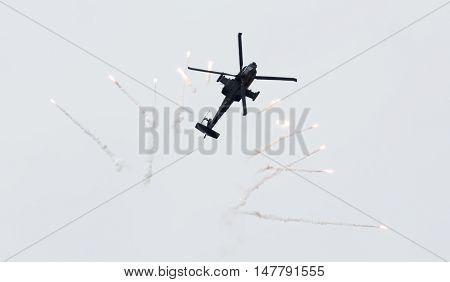 Leeuwarden, The Netherlands - Jun 10, 2016: Dutch Ah-64 Apache Attack Helicopter Firing Off Flares D
