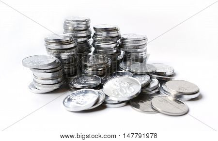 Rupiah silver coins on a white background