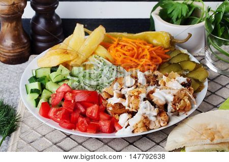 shawarma still life on a plate on top of meat chicken cabbage carrot onion pepper still life