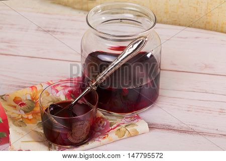 Red fruit compote and vintage ladle Provence still life