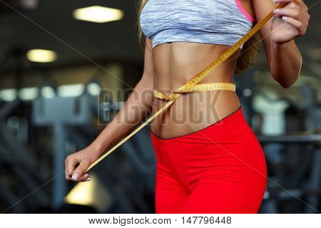 Woman measuring perfect shape of beautiful waist healthy lifestyles concept
