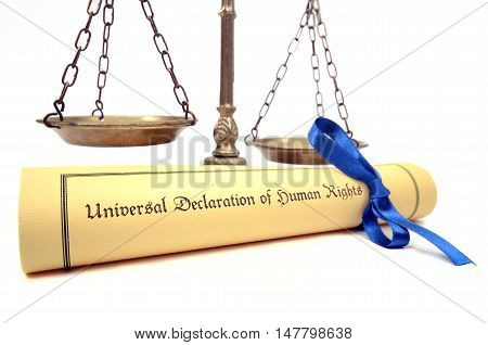 Scales of justice and The Universal Declaration of Human Rights Human rights concept isolated.