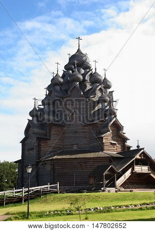 Saint-Petersburg, Russia - September 18, 2016: Russian wooden church has a lot of domes. Traditional architecture in the culture of Russia. Orthodox Christian Church of the Intercession of the Holy Virgin. St. Petersburg.