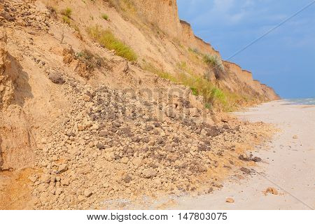large boulders fell after landslide on the seaside