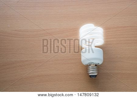 Electric lamp with lighting on wood flooring The concept of intellectual.