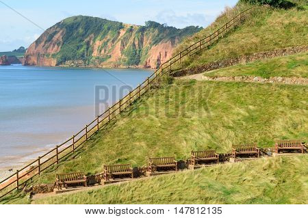 Wooden fence and benches with seaview in Sidmouth Devon