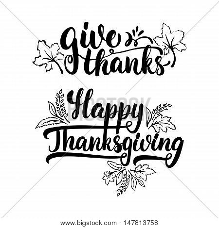 Give thanks and Happy Thanksgiving - lettering calligraphy phrase with leaves. Autumn greeting card isolated on the white background