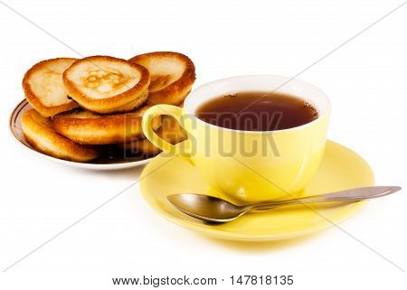 Tea and pancakes isolated on white background with clipping patch